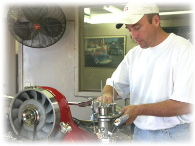 Patricks Downs tunes up a CB Turnkey Engine, in the Dyno Room